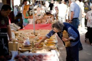 Elderly woman shopping at a farmers market