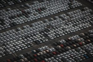 Rows of vehicles parked in a parking lot