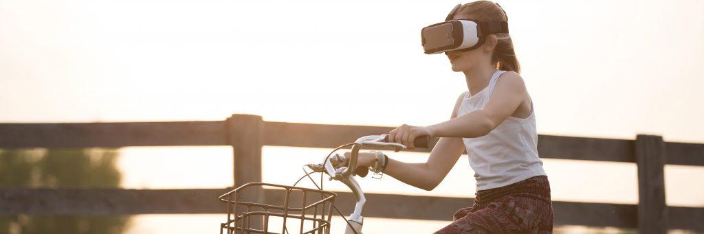 Woman rides a bike wearing a virtual reality headset