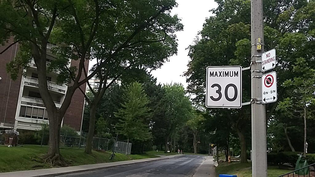 "A street has a ""Maximum 30km/h"" speed limit sign"