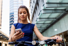 cyclist stopped to check her mobile device