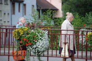 Elderly women walking across a bridge