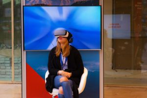 Woman uses VR headset